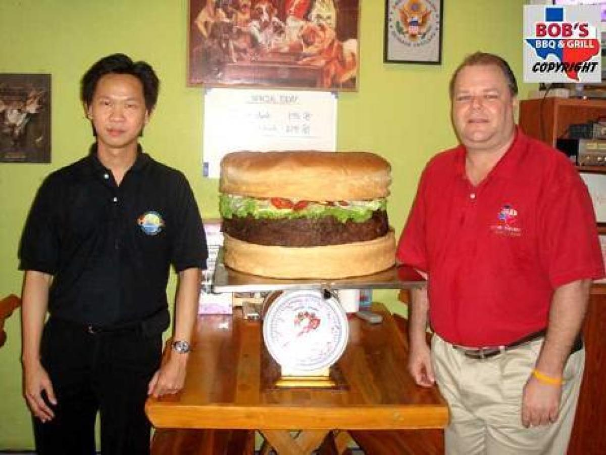 """Weighing in at 78.5 pounds, <a href=""""http://www.cheese-burger.net/stories/worlds-largest-hamburger-update.html"""">Big Bob's Tex"""