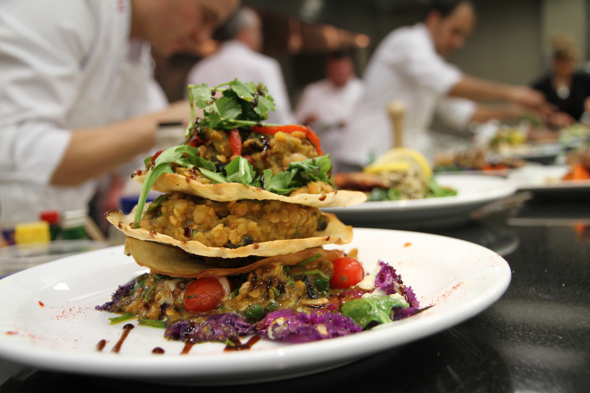 A pyramid of sautéed vegetables, baked lentils and crisp baby greens layered between toasted tortillas  Photo: VIA Rail Can