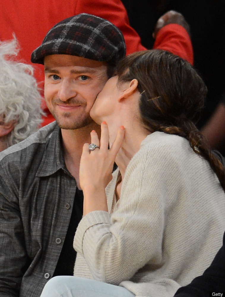 Justin Timberlake smiles as Jessica Biel gives him a kiss coutside as the Los Angeles Lakers take on the Denver Nuggets in Ga