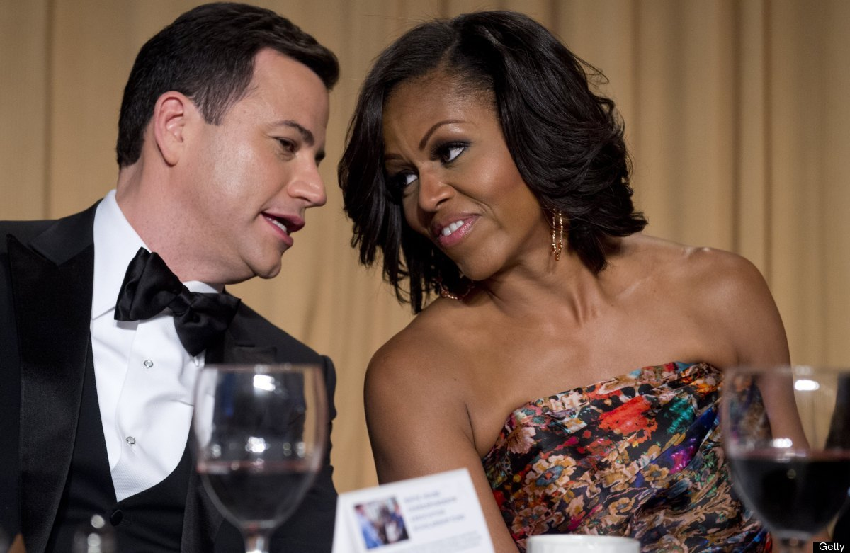 Television host Jimmy Kimmel (L) sits alongside First Lady Michelle Obama (R) during the White House Correspondents Associati