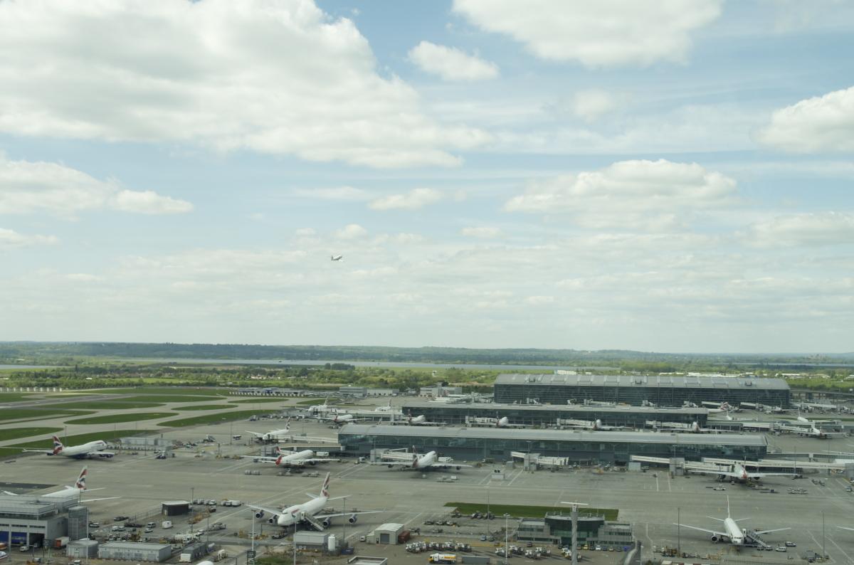 A plane takes off past Terminal 5.