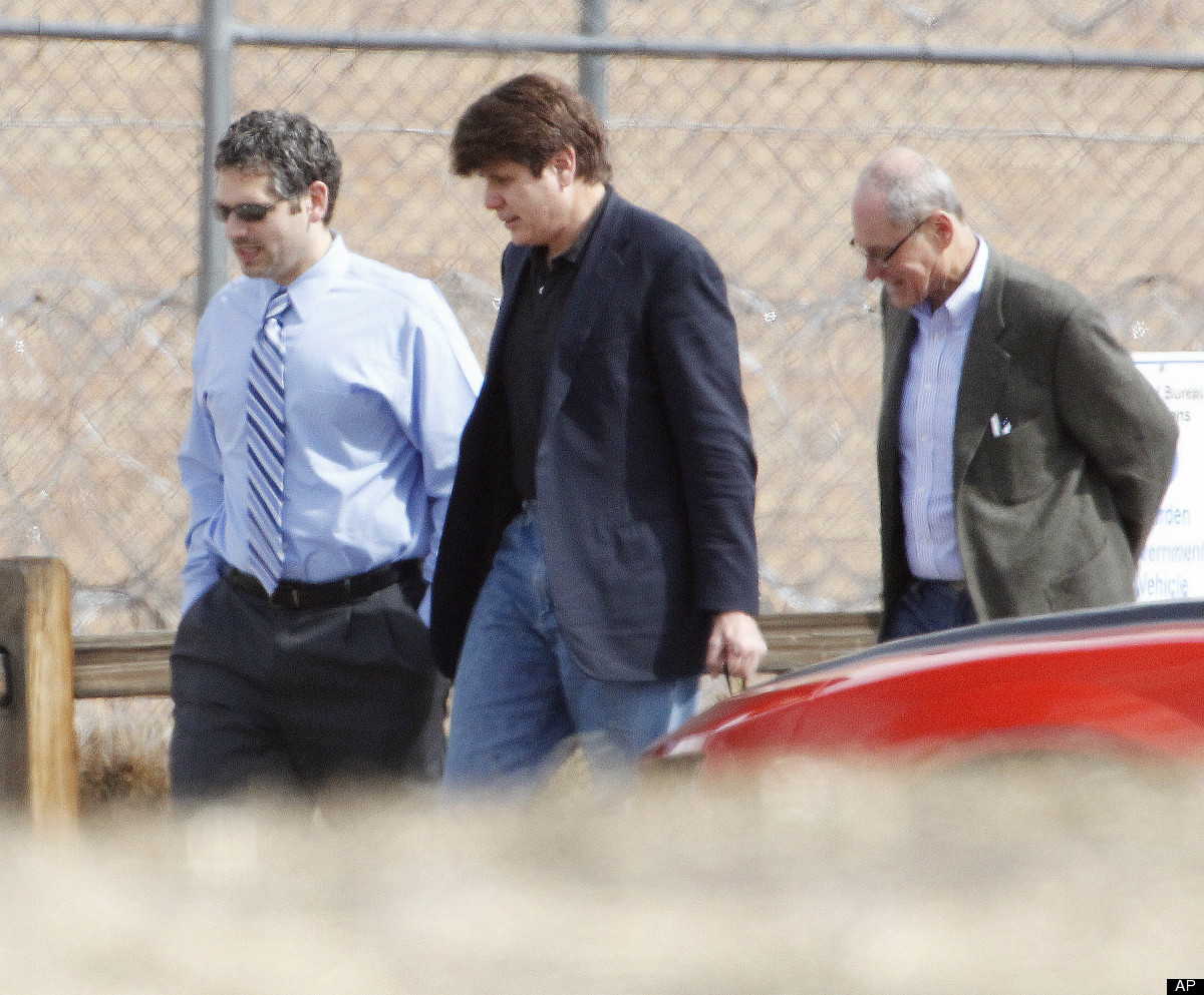 Former Illinois Gov. Rod Blagojevich, center, walks with attorneys as he arrives at the Federal Correctional Institution Engl