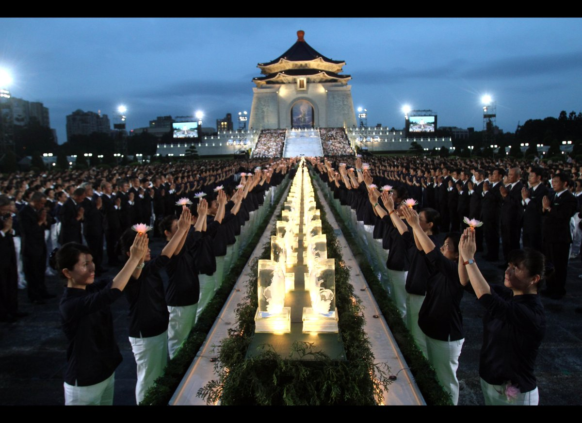 Taiwanese people pray together during the Taiwan National Buddha's Birthday celebration in front of the Chiang Kai-shek Memor
