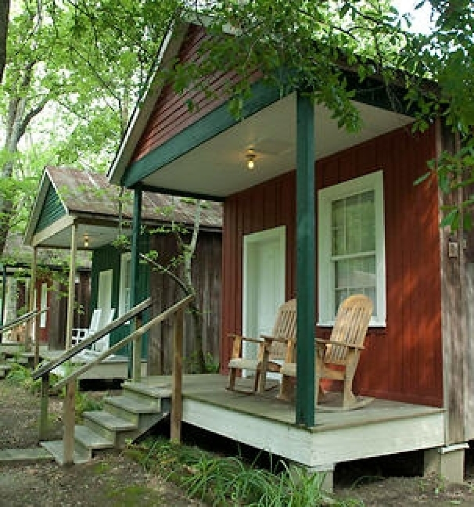 The shotgun houses that make up this B&B got their name from the idea that if a shotgun was fired from one end, the bullet co
