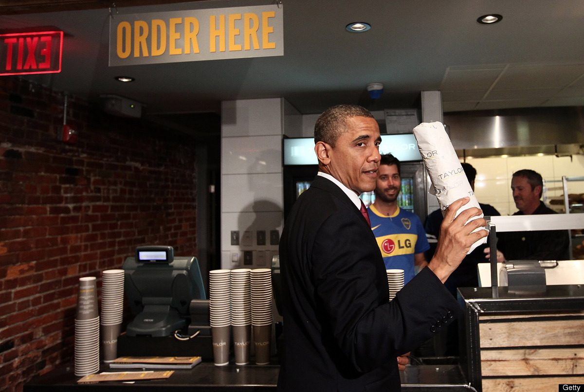 Obama holds up a hoagie he purchased after visiting Taylor Gourmet, a sandwich restaurant, May 16, 2012 in D.C.
