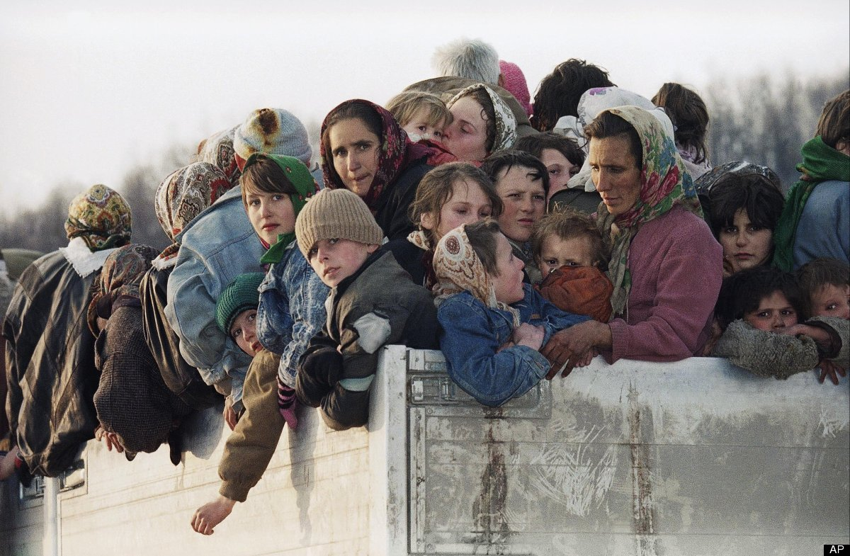 In this Monday March 29, 1993 file photo evacuees from the besieged Muslim enclave of Srebrenica, packed on a truck en route
