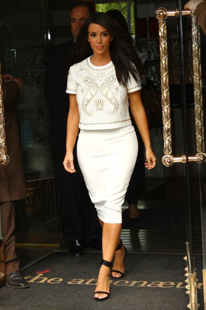 We credit Kanye with her newfound obsession with a) tasteful dressing and b) black and white. And she took out her extensions