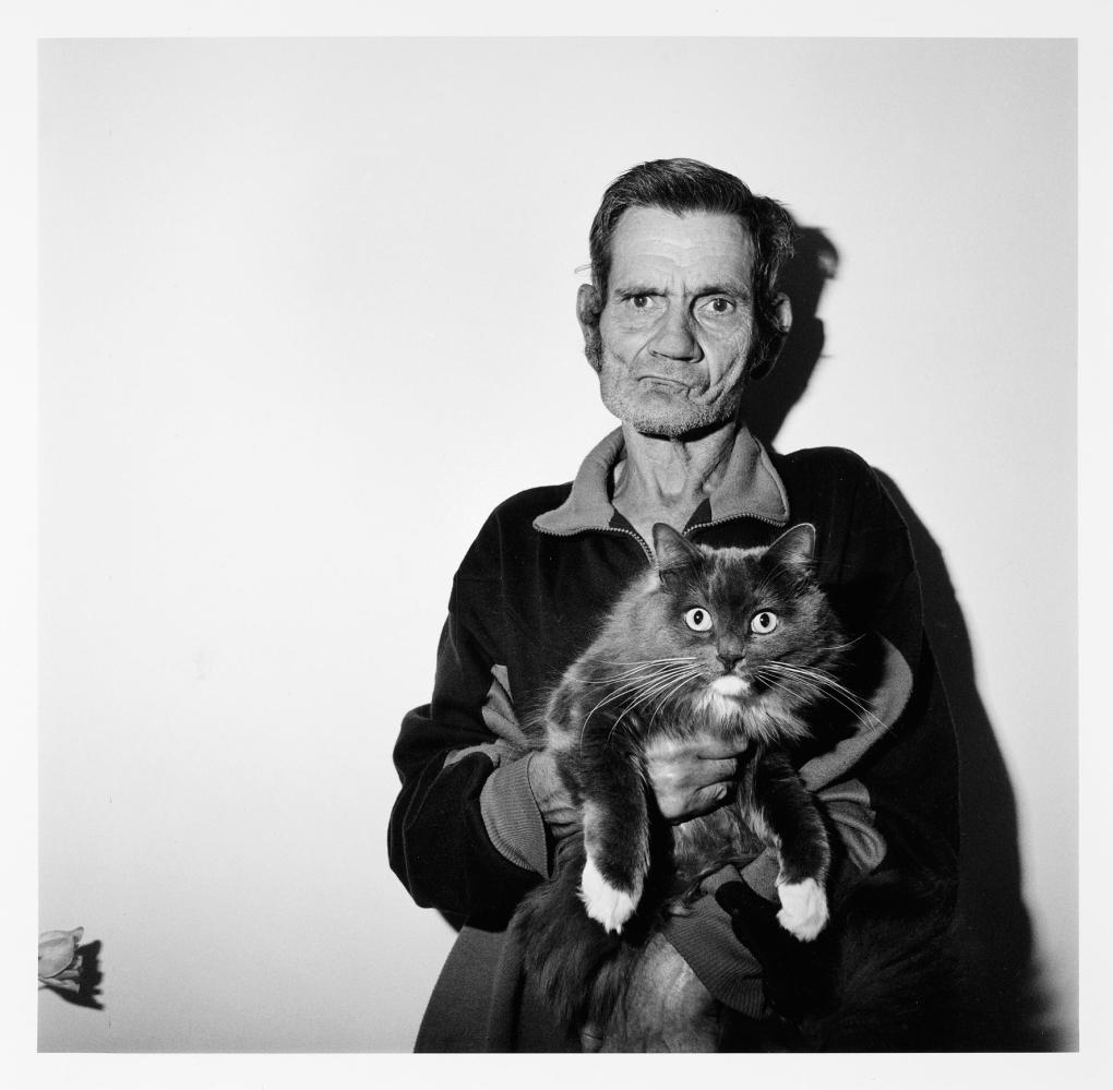 Roger Ballen  Man holding cat, 1995  from the series: Outland  development gelatin paper, 36 x 36 cm  © Roger Ballen