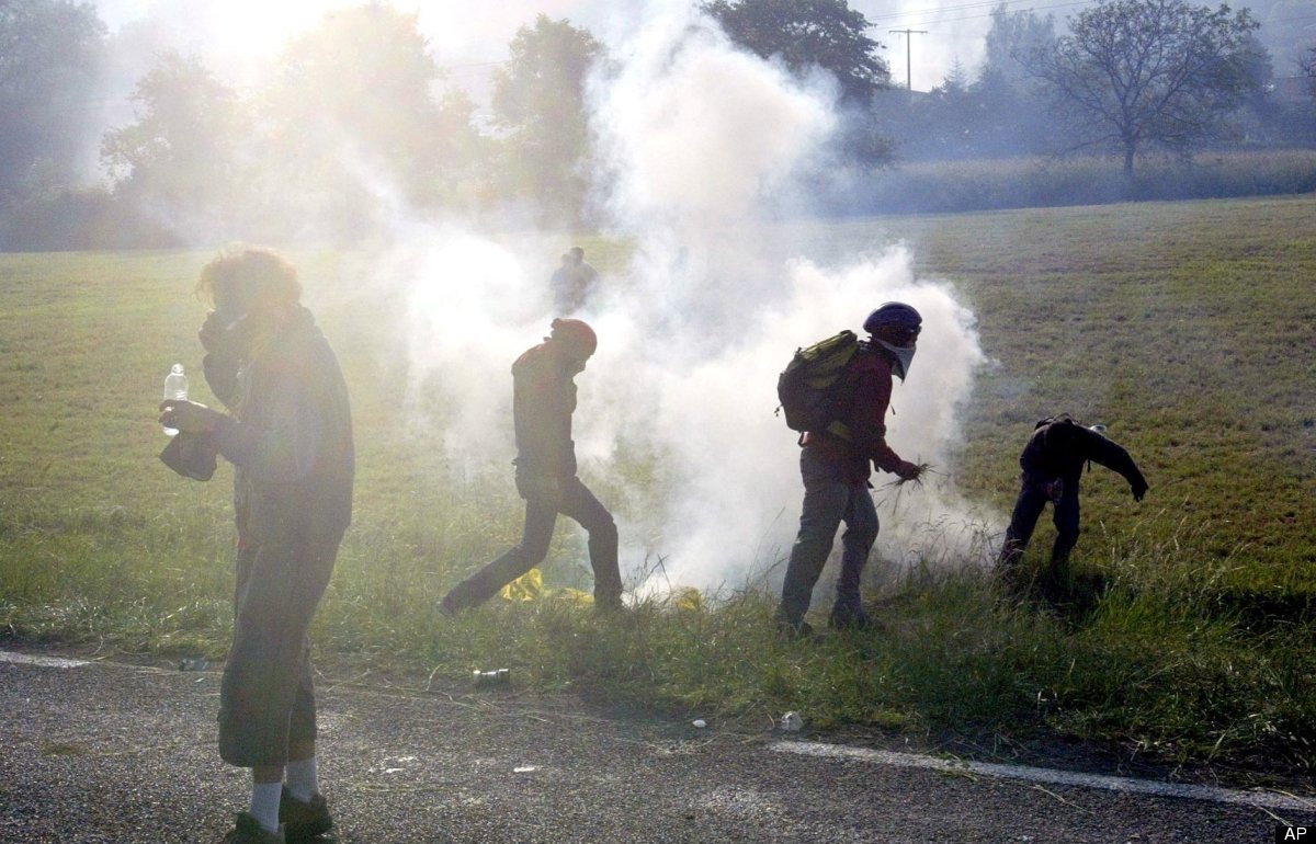 Police fired tear gas at a group of anti-G8 demonstrators, who had designated June 1, 2003 a day of protest, who tried marchi