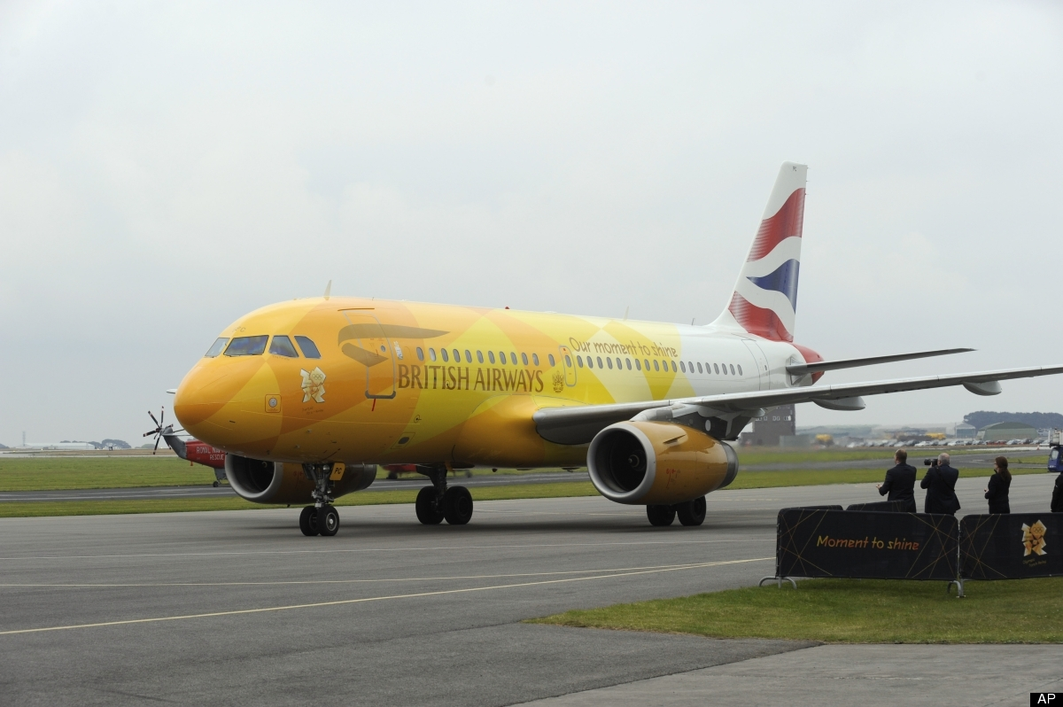 British Airways Firefly flight BA2012 carrying the Olympic flame lands at RNAS Culdrose, Cornwall, England, from Greece, Frid