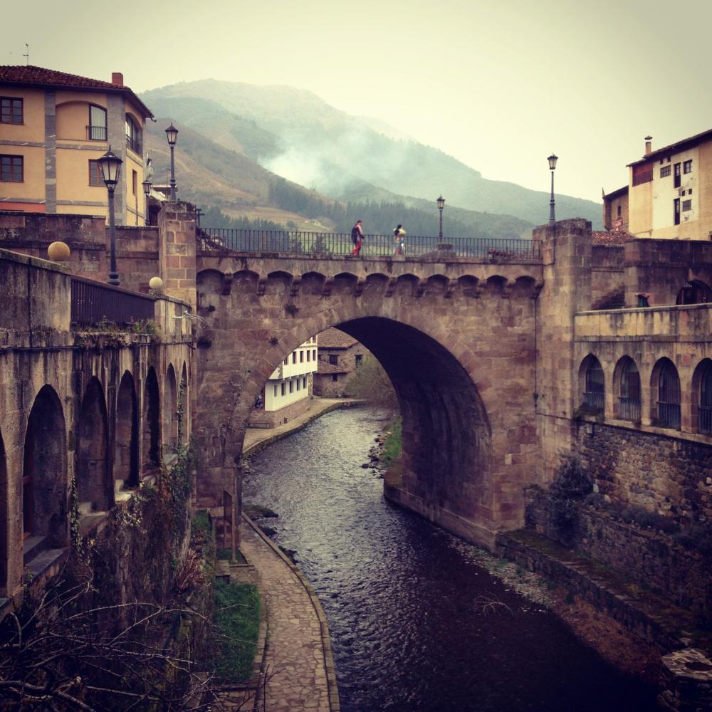 A river runs through the center of Potes, a small medieval town in the Picos De Europa.