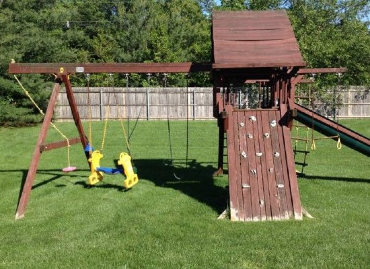 The swingset in the backyard