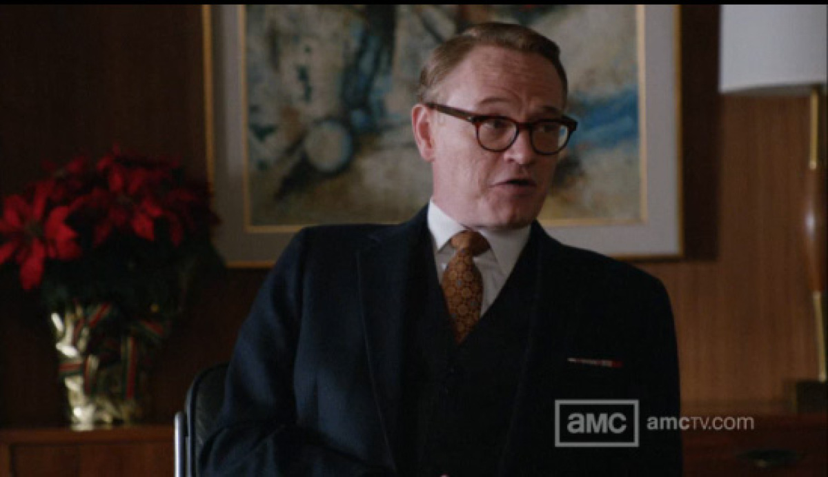 Like his suit, there's always something off about Lane: The suit is technically right, and then there's that ugly tie.