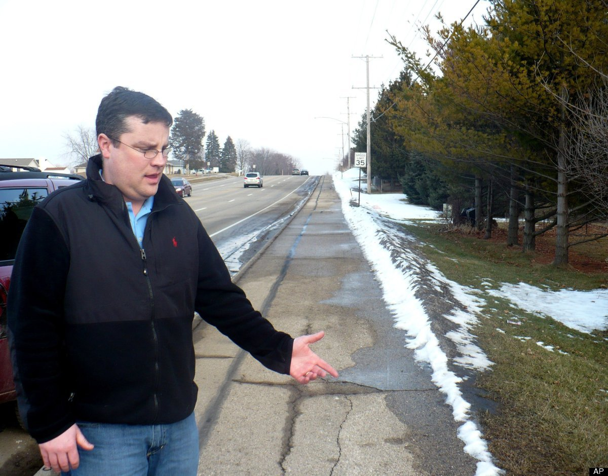 Mike Vega points to the area of sidewalk in Madison, Wis., Wednesday, Feb. 15, 2012, where he discovered a starving 15-year-o