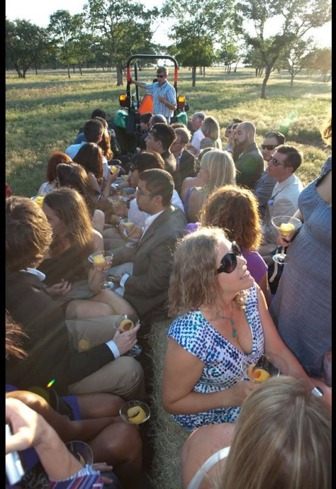 The welcome hayride into the sunset, through the animal kingdom, to John Paul DeJoria's ranch house.  Photo Credit: Johnny
