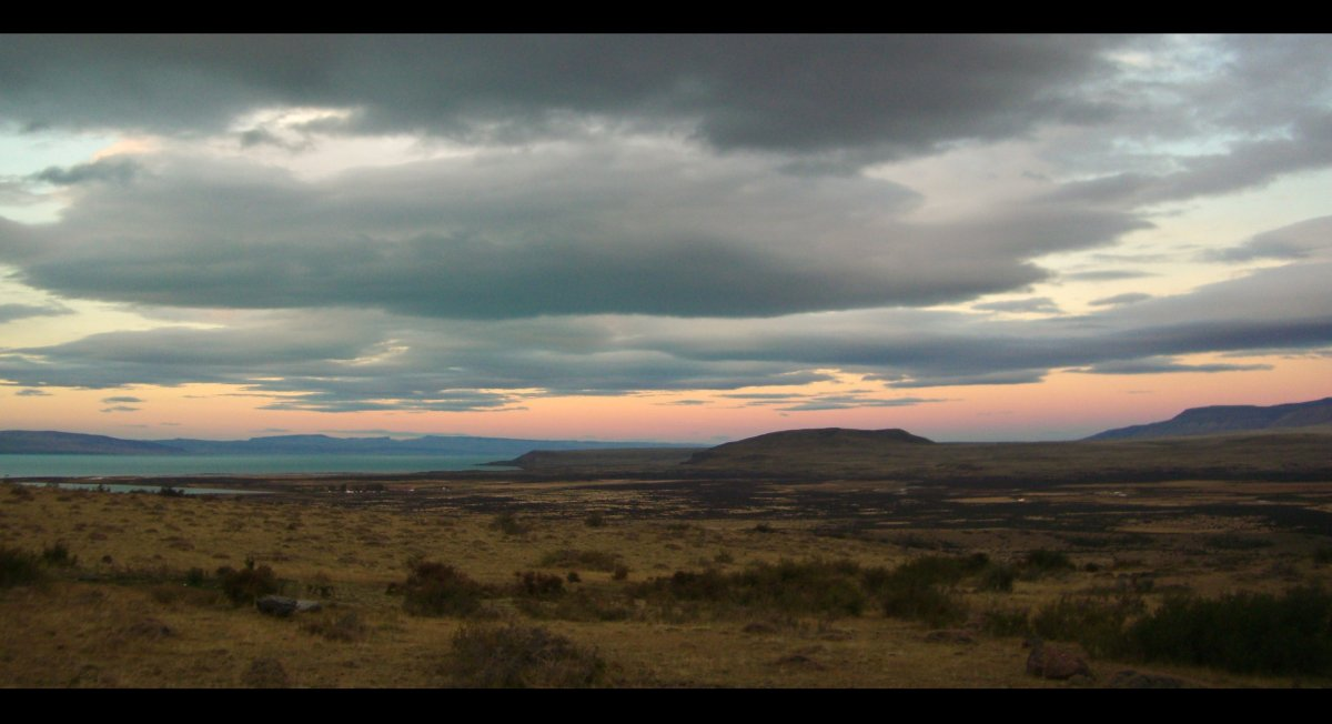 "The day sets across Lake Argentino and the Patagonia Steppe from <a href=""http://www.jacadatravel.com/Hotel/57/eolo"" target="""