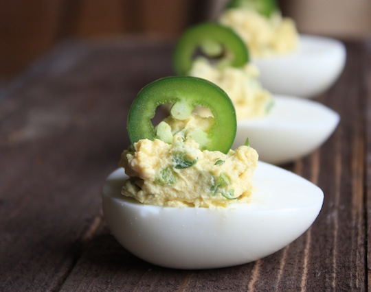 "<strong>Get the <a href=""http://raisedonaroux.com/fingerfood-jalapeno-deviled-eggs/"" target=""_blank"">Jalapeño Deviled Eggs re"