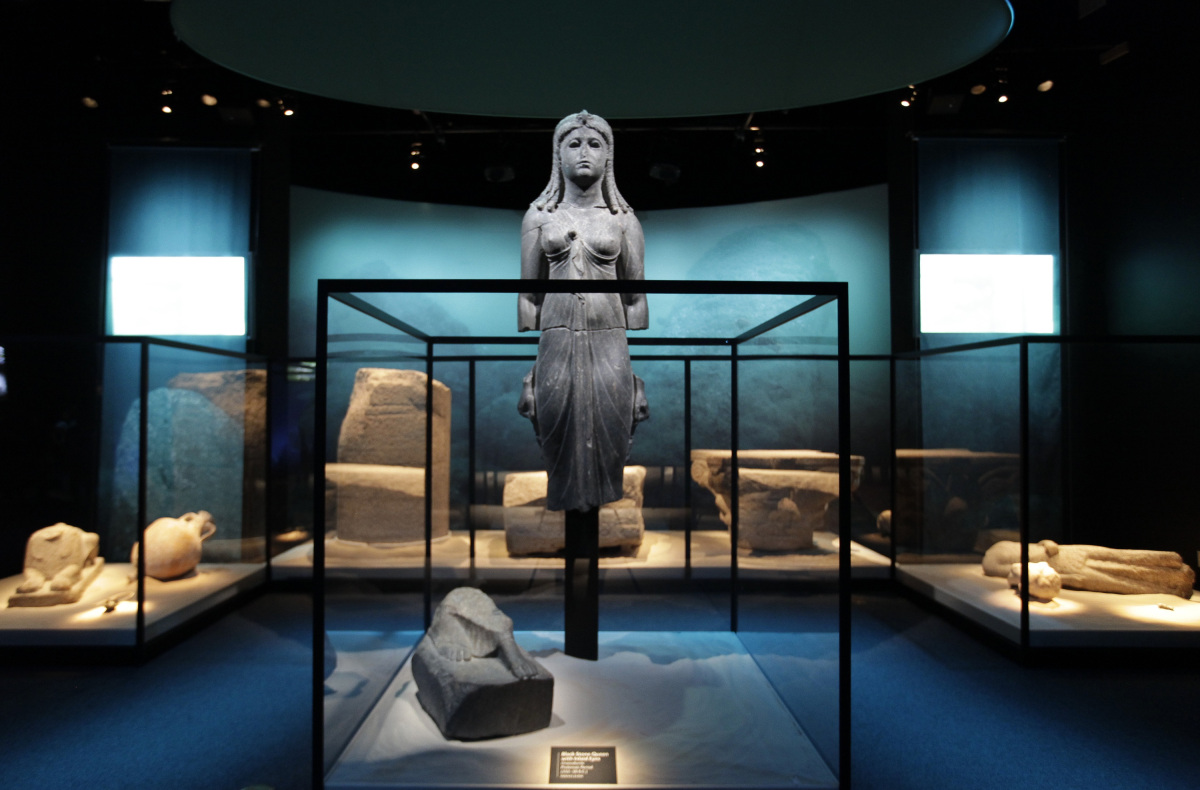 "A Graeco-Egyptian statue, part of the exhibit ""Cleopatra: The Search for the Last Queen of Egypt,"" is displayed at the Califo"