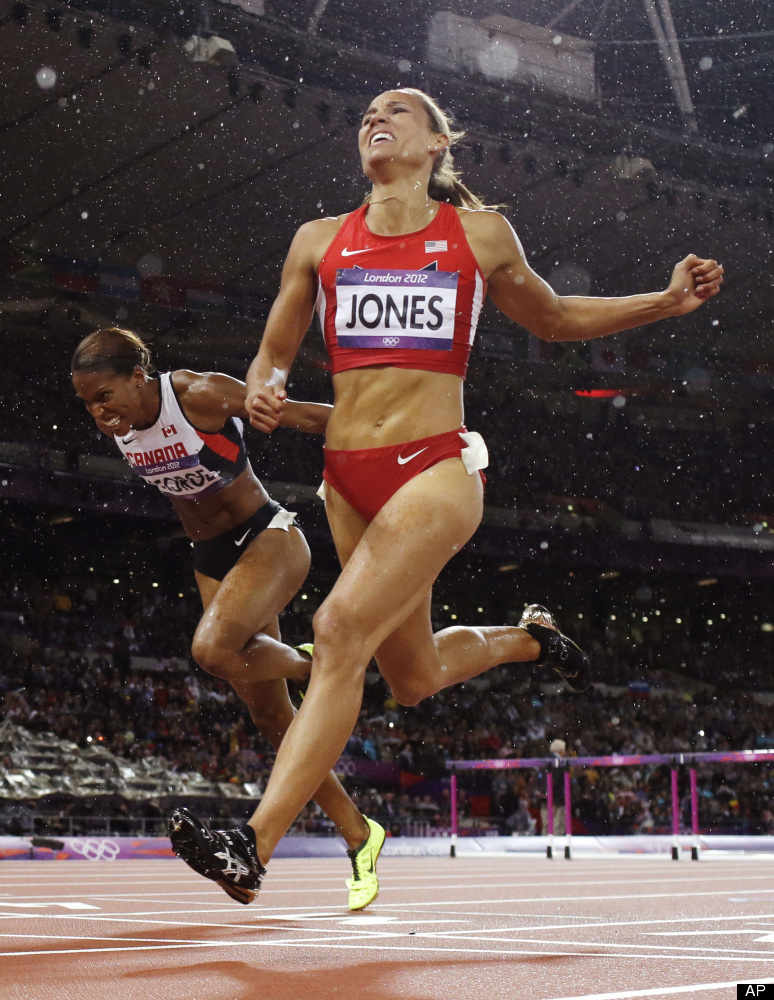 In this photo taken Tuesday, Aug. 7, 2012, United States' LoLo Jones, right, crosses the finish line to place fourth in the w