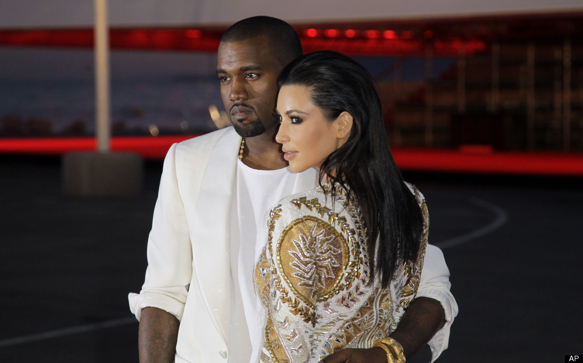 Singer Kanye West, left, and television personality Kim Kardashian arrive for the screening of Cruel Summer at the 65th inter