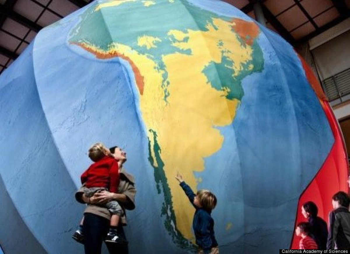 """Entry into the exhibit is through a dramatic crack in a 25-foot-diameter model of the Earth. <a href=""""http://www.calacademy.o"""