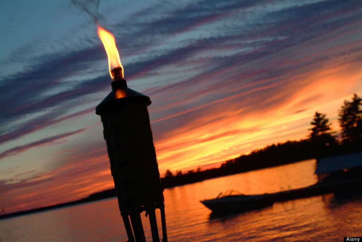 """Start your BBQ closer to sundown and create a sexy vibe with lots of candles and torches, Cantave suggests.  """"In the evenin"""