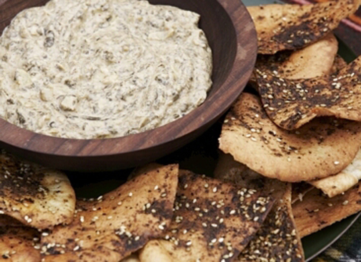 Cream cheese and a little bit of parmesan make this dip nice and rich. And depending on how you like it, you can keep the art