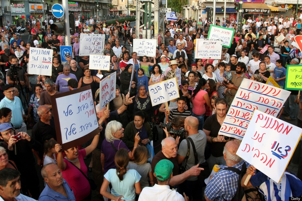 Hundreds of people demonstrate in the impoverished Hatikva neighborhood of the southern Mediterranean city of Tel Aviv on May