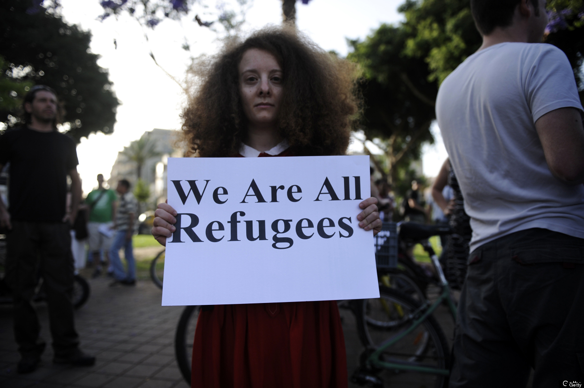 An Israeli protester holds a slogan against racism and the government's policy regarding the African migrants on May 24, 2012