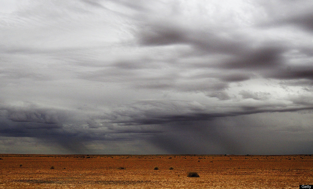 Rain clouds sweep over the desert plains on the Birdsville Track June 9, 2005 near Marree, Australia. (Photo by Ian Waldie/Ge