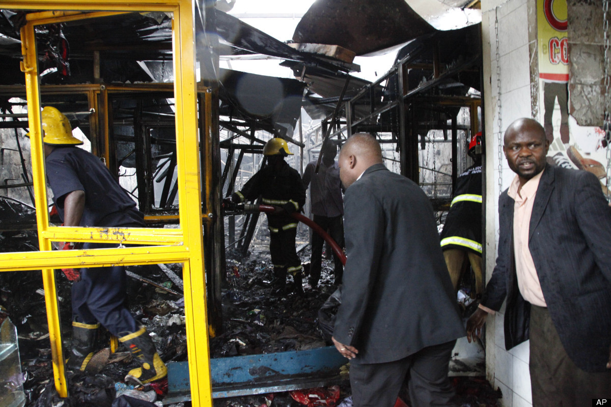Kenyan Firefighters and Kenyan plain clothes police officer at a shop after the explosion on a busy road in Nairobi, Kenya, M