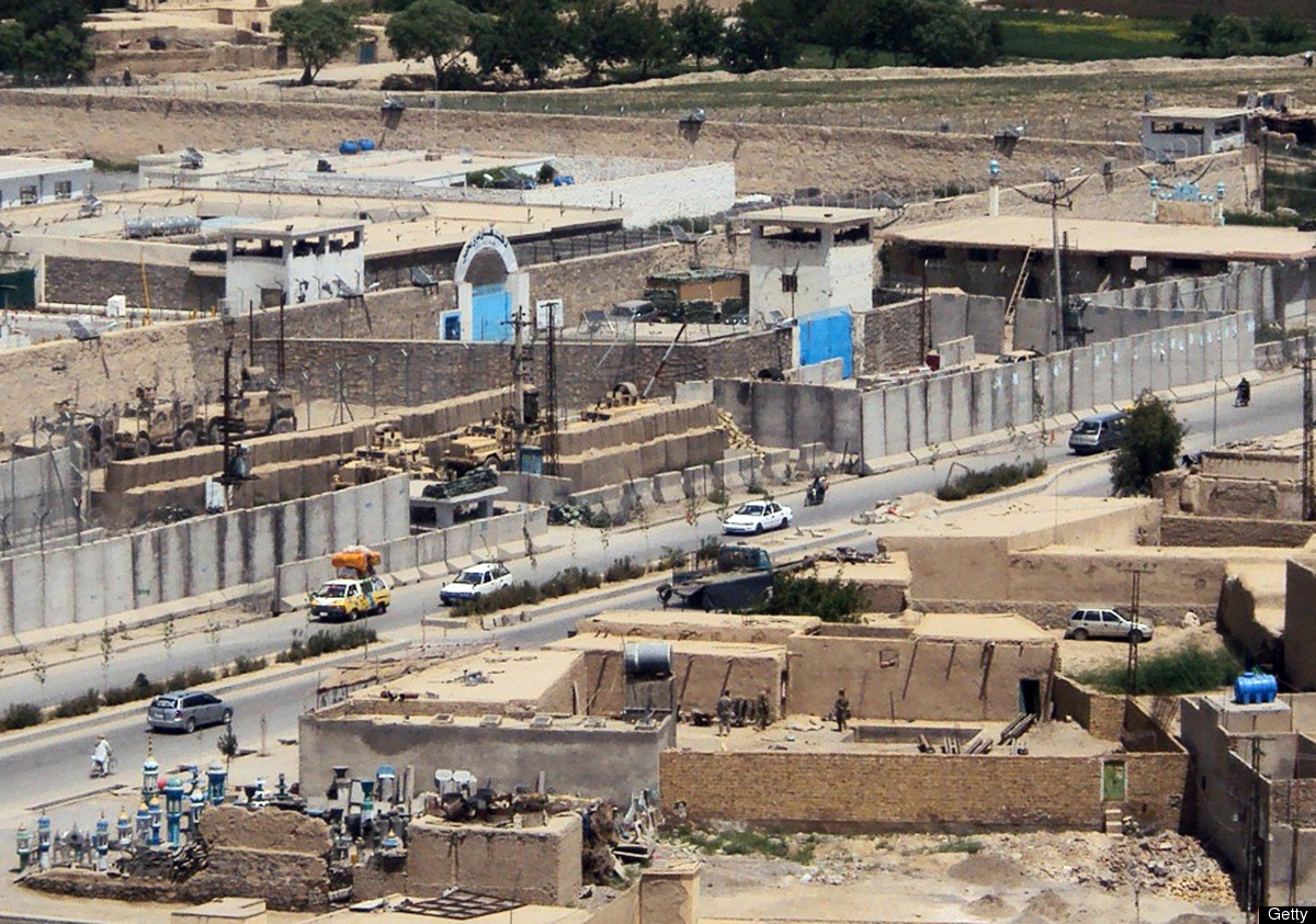 This picture taken on April 27, 2011 shows a general view of Kandahar jail (top centre) and the house (bottom right) from whi