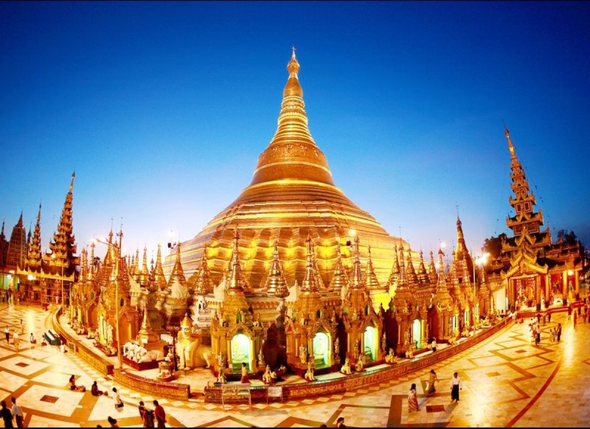 Nestled in the heart of the former capital, Yangon, Shwedagon Pagoda's gleaming stupa greets its visitors with a golden excla