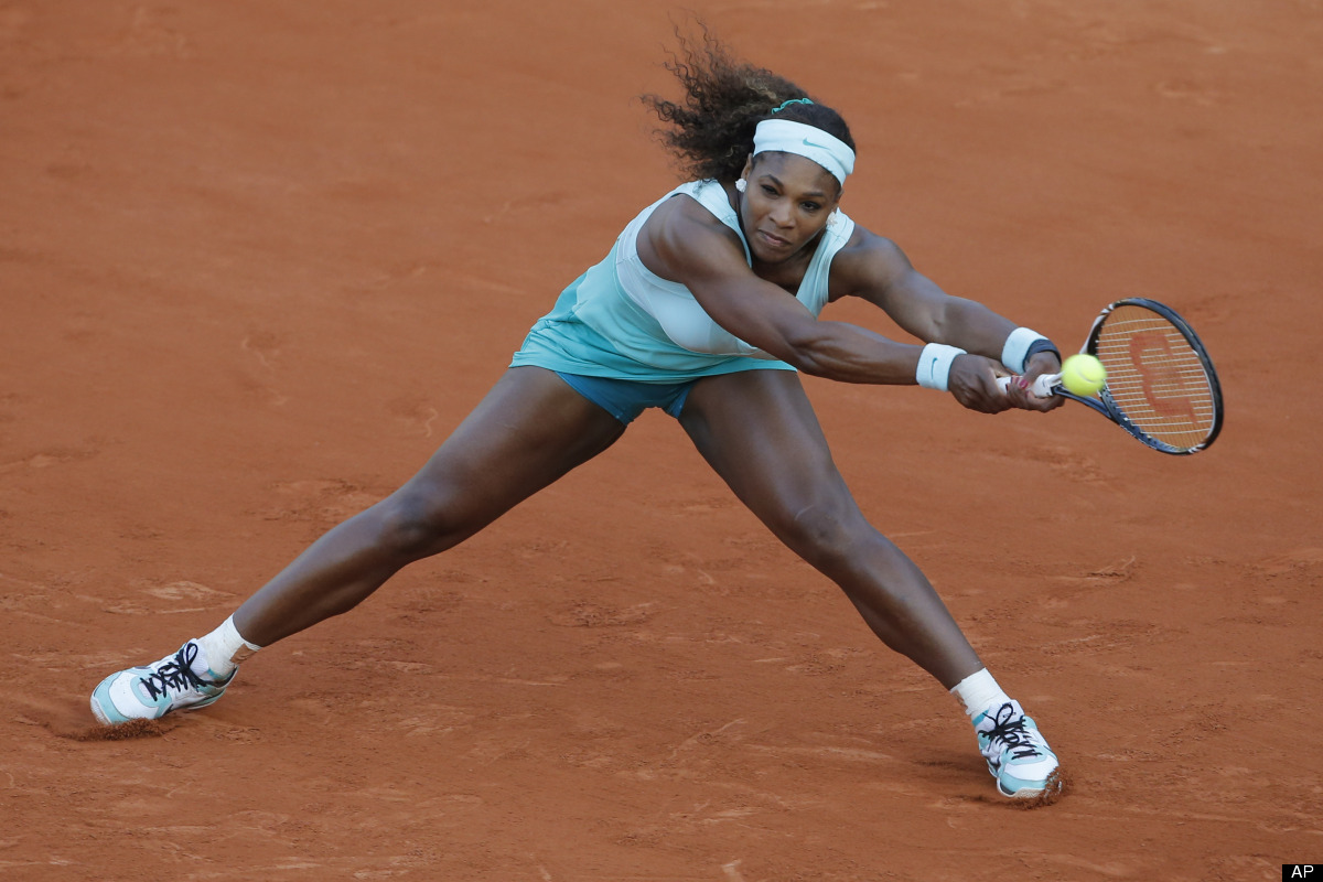 Serena Williams of the US returns in her first round match against Virginie Razzano od France at the French Open tennis tourn