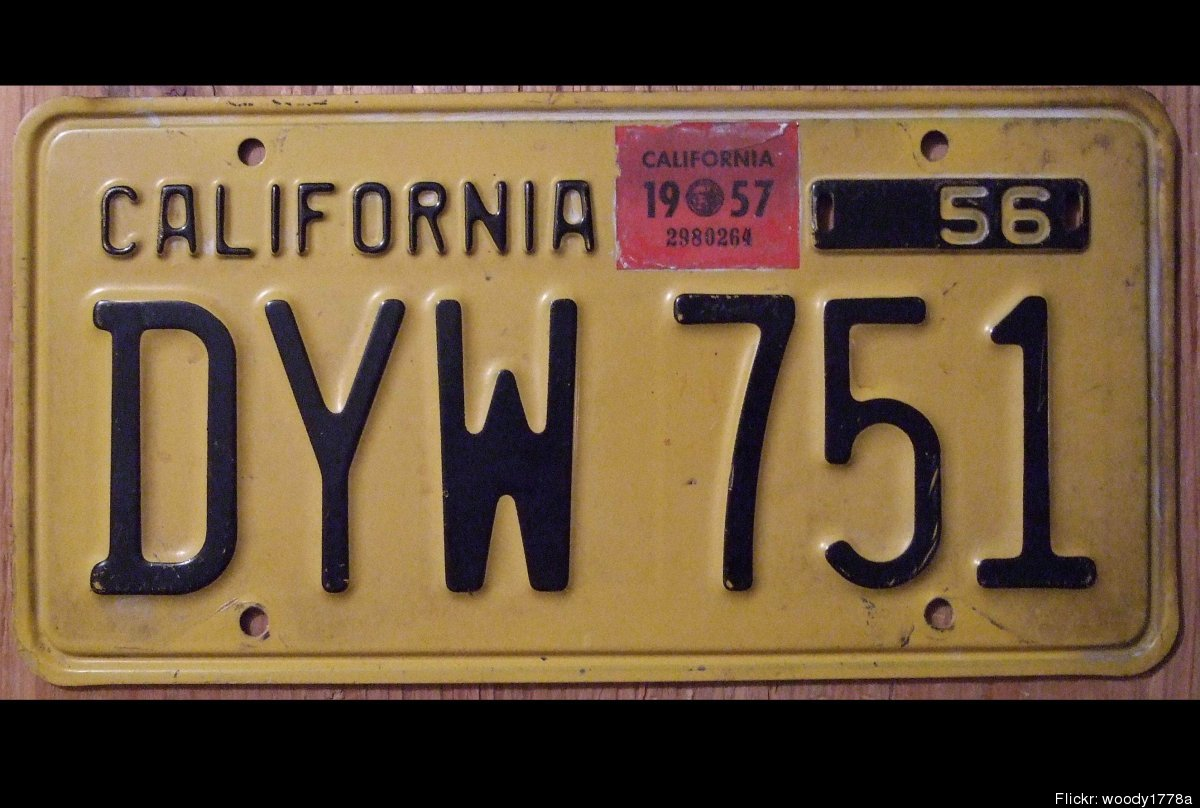 """""""In 1956 California issued a new black on yellow baseplate to be validated with stickers in 1957 discontinuing the use of met"""