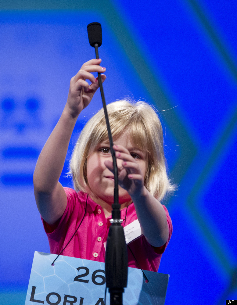 Six-year-old Lori Ann Madison, of Woodbridge, Va., the youngest contestant in the history of the National Spelling Bee, reach