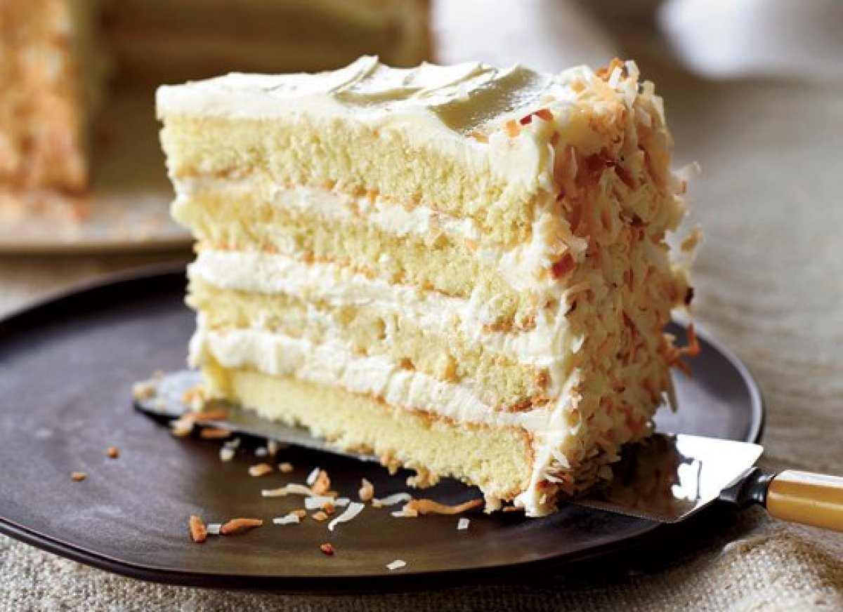 This Impressive Cake Features Four Layers Of Rum Brushed Yellow Filled And Frosted With Recipes