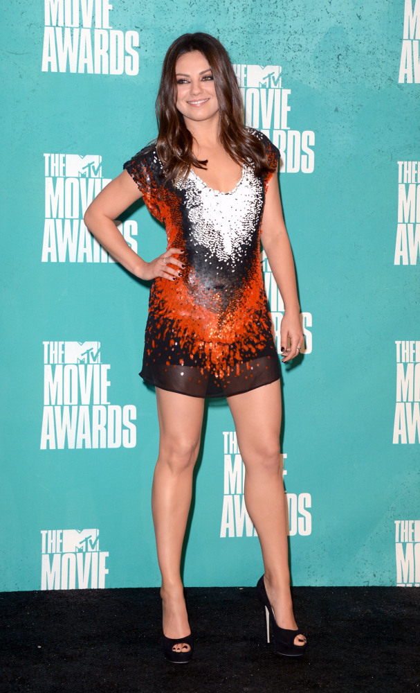 The cut and sequin pattern does nothing for her beautiful shape.