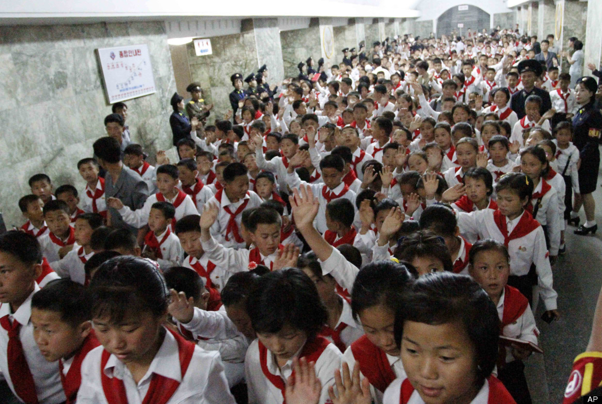 North Korean students who were selected as delegates to the Korean Children's Union tour a subway station in Pyongyang, North