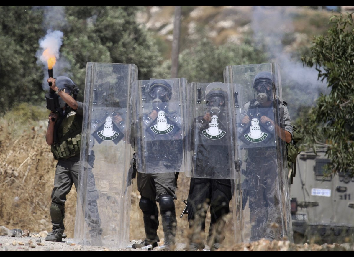Israeli border police fire teargas towards Palestinian demonstrators during clashes with Palestinians in the northern West Ba