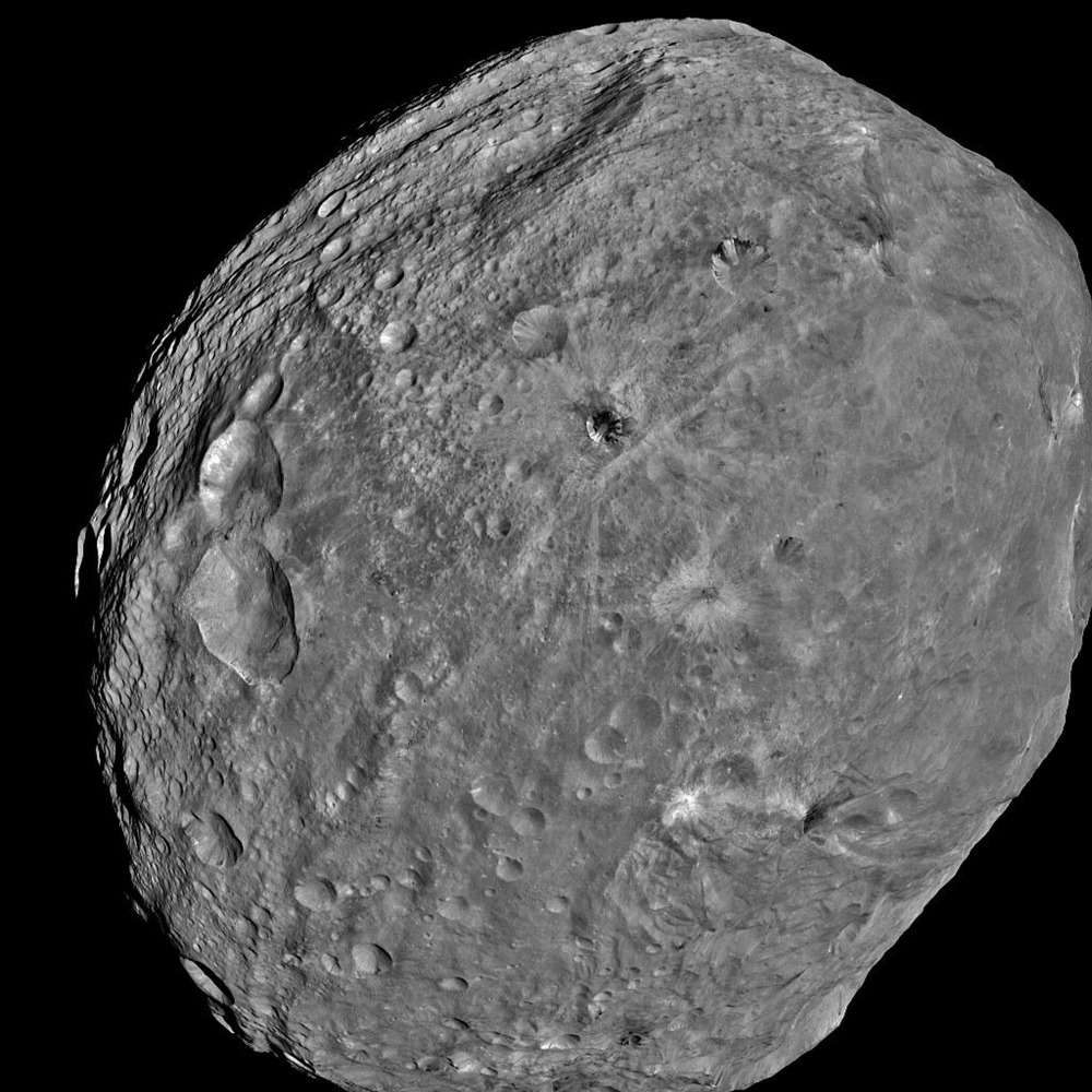 In this handout from NASA, the giant asteroid Vesta is seen in an image taken from the NASA Dawn spacecraft about 3,200 miles