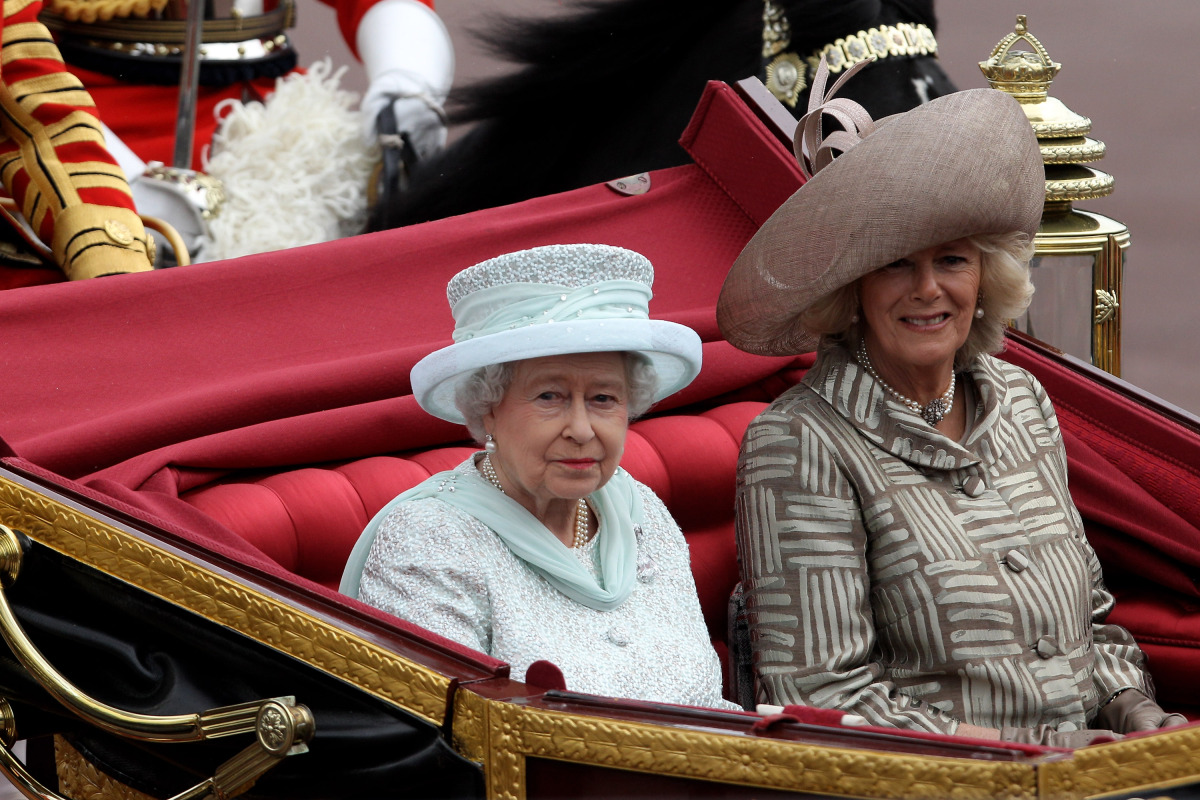 Queen Elizabeth II and Camilla, Duchess of Cornwall, look on during the Diamond Jubilee carriage procession. <br> Getty pho