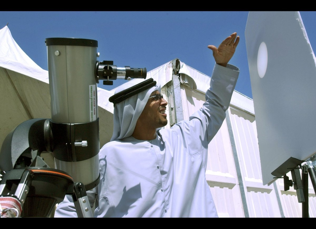 Nazar Sallam, a technician from the Emirates Astronomical Society, prepares a telescope to view the Venus transit across the