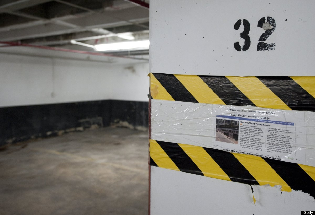 A historical note marks parking spot D32 in a parking garage in the Rosslyn where <em>Washington Post</em> reporter Bob Woodw