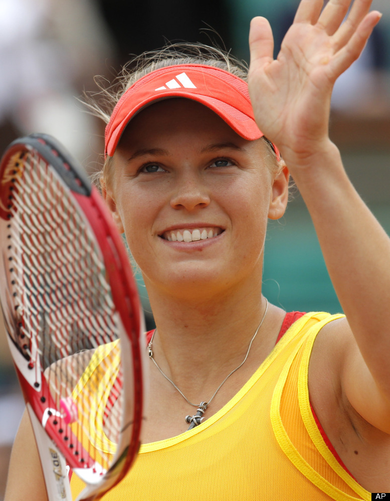 Denmark's Caroline Wozniacki waves after defeating Australia's Jarmila Gajdosova during their second round match in the Frenc