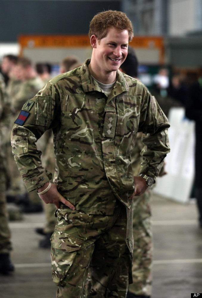 Britain's Prince Harry, smiles whilst speaking with service personnel during a visit to RAF Honington, near Bury St Edmunds i