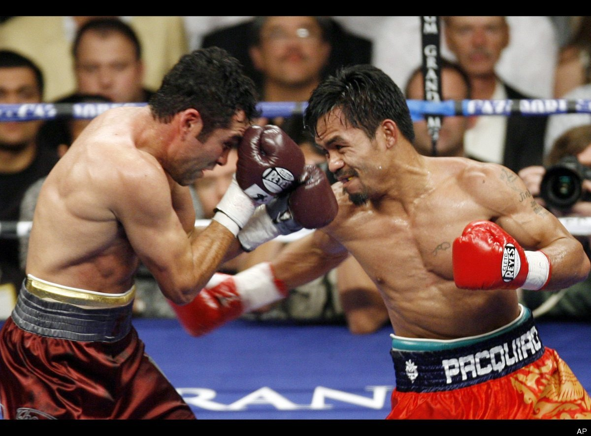 WBC lightweight champion Manny Pacquiao throws a right to Oscar De La Hoya during the third round of their welterweight boxin