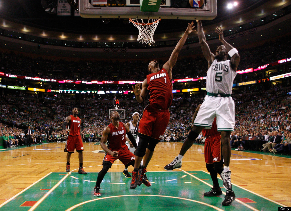 Kevin Garnett #5 of the Boston Celtics attempts a shot in the first half against Chris Bosh #1 of the Miami Heat in Game Six