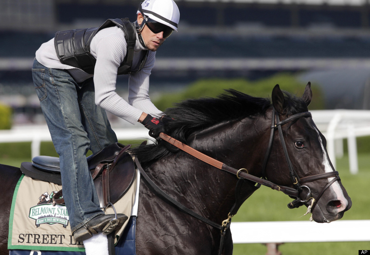 Exercise rider Richard Johnson guides Street Life around the track during a workout at Belmont Park, Wednesday, June 6, 2012