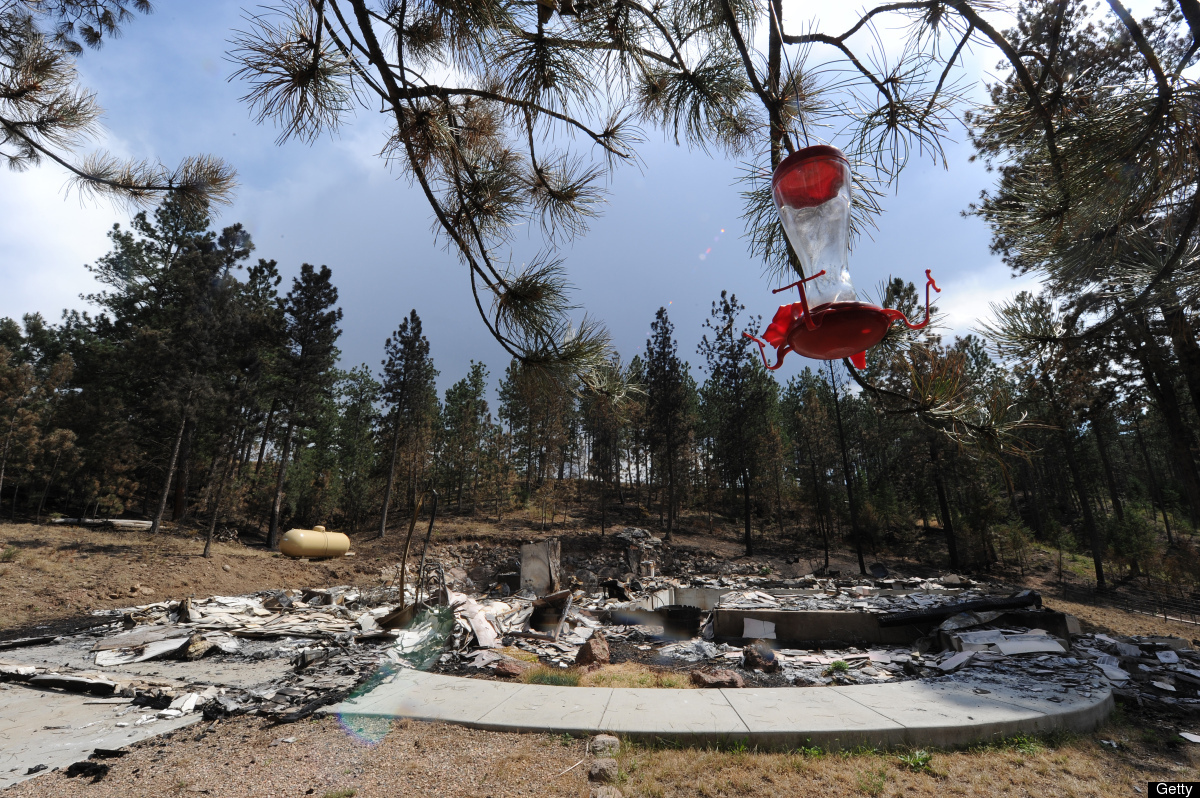 A  birdfeeder hangs in front of a home destroyed by the High Park Fire, in Bellvue, Colorado west of Fort Collins June 30, 20